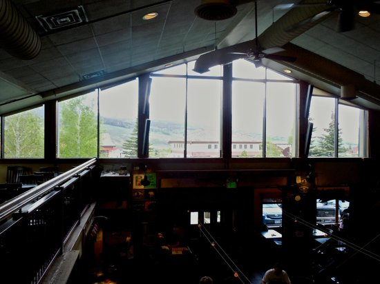 Dillon Dam Brewery: Upstairs, looking out the window, over the bar. Hard to see the beauty of the mountains in photo