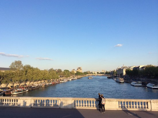 L'Open Tour: View of Seine River at sunset