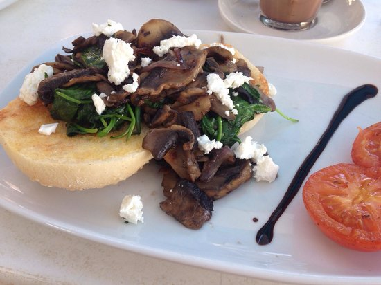 Cafe Aqua: sliced field mushrooms sauteed with garlic butter, red onion, baby spinach, and danish feta