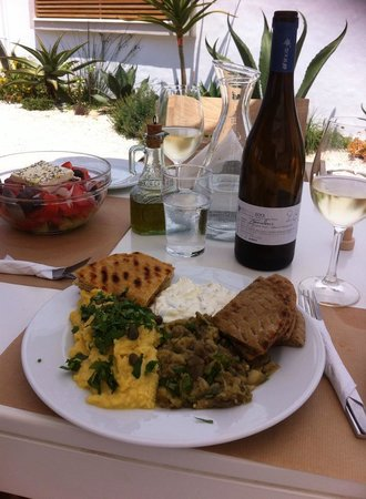 "Ammos Hotel: The ""Triada""  Eggplant, Tzatziki and Fava puree served with wheat, white or a mix of pita!"