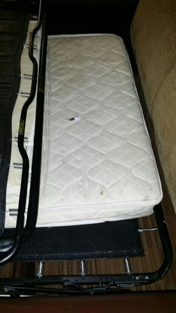 Extended Stay America - Orange County - Brea : Disgusting mattress with gum wrapper and debris underneath. Twin size mattress on a queen sized