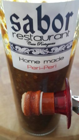 Sabor homemade peri-peri sauce. So hot that it destroyed my wine stopper. Yum yum.