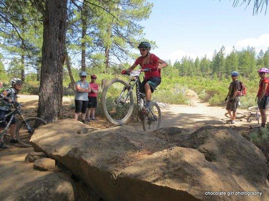 Cog Wild Mountain Bike Tours: Coach Lindsey demonstrates