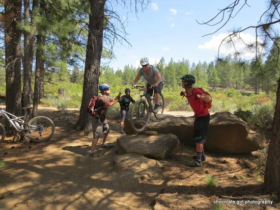 Cog Wild Mountain Bike Tours: learning new sills on the trail