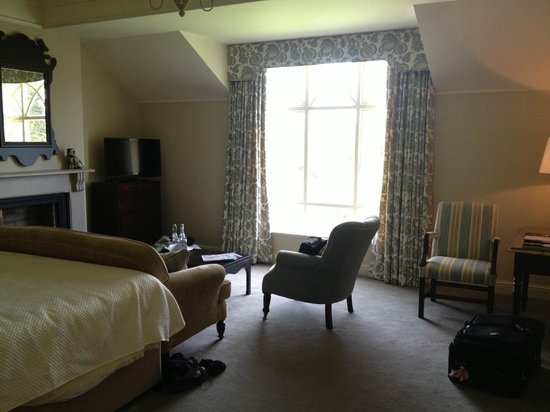Ballynahinch Castle Hotel: bedroom with window overlooking water-spectacular view