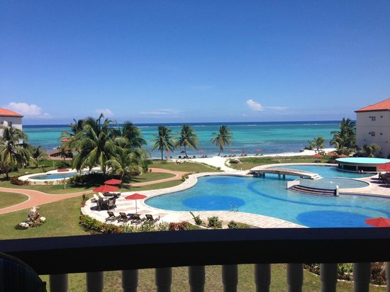 Grand Caribe Belize Resort and Condominiums : Beat that!!  What a gorgeous view from our balcony! D8 was the best couple's condo!