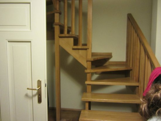 stairs leading from living room to upstairs bedroom