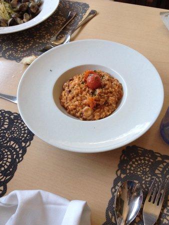 Restaurante Bel Posto: rissoto de chipirones, super bueno.