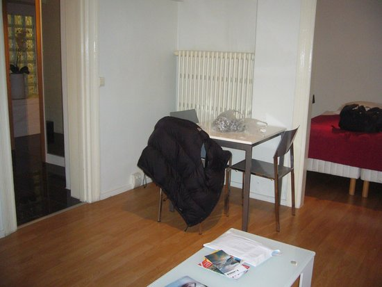 Room With a View Apartments: Small dining table in living room