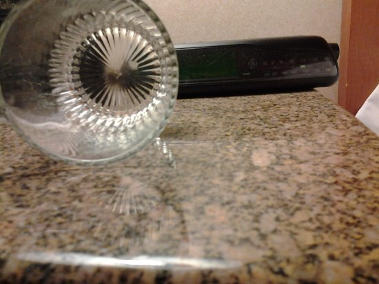 Hollywood Casino St. Louis Hotel: Crud in bottom of a dirty glass in the room