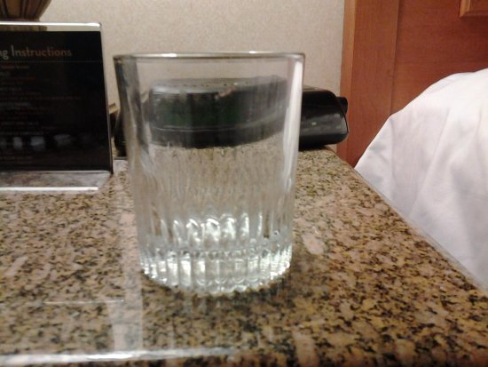 Hollywood Casino St. Louis Hotel: Lipstick and food on glass in room-all four glasses were dirty