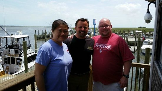 Island House Restaurant: My girlfriend and I with the owner on the restaurant's deck