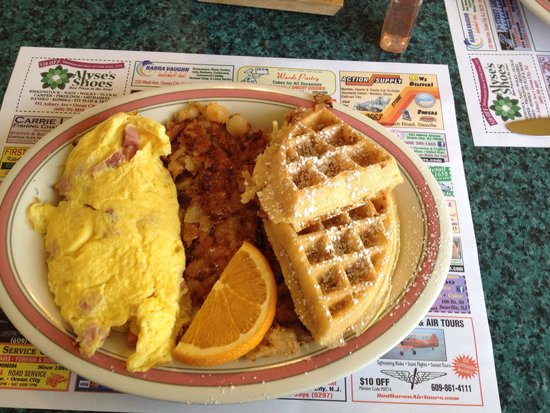 Augie's Omelette & Waffle: Combo ham & cheese omelette with half granola waffle and hash browns