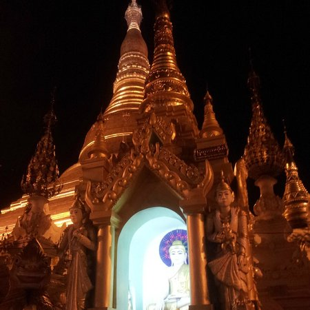 Shwedagon Pagoda: One of the many smaller Buddha statues that have been donated by followers