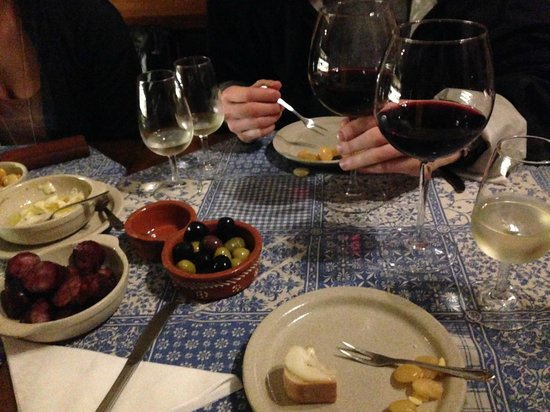 Taste Porto: One of the many amazing stops. Fresh cheese, bread, olives, chorizo, and 3 glasses of wine!