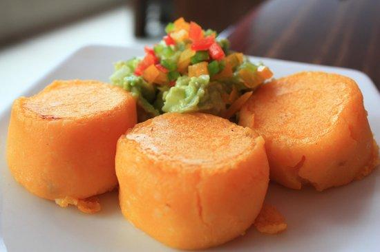 Achiote Ecuador - Cuisine: Llapingachos (potato cakes filled with cheese)