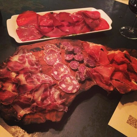 "Vivanda : The back platter is the bresaola and rocket ""salad"" and the front is one of the meat platters. A"