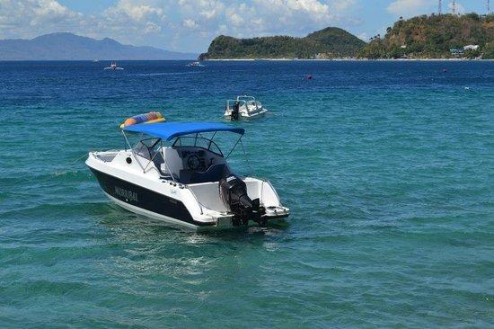 Talipanan Beach: Motor boats for parasailing and banana boat ride.
