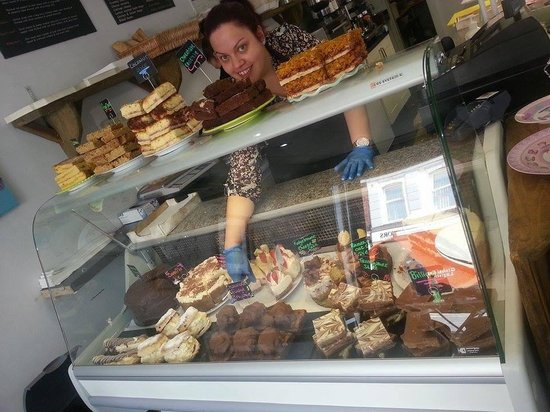 Deli-licious: The lovely Sarah showing off the cake cabinet 🍰