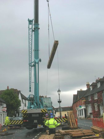 The Church House: A huge crane lifts individual timbers