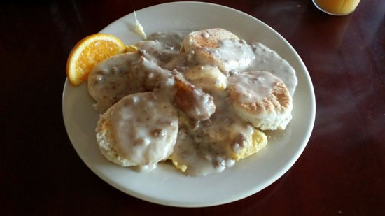 Village Cafe and Bistro: Biscuits and gravy with eggs on it. Delicious