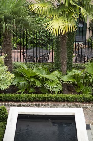The Planters Inn Courtyard is inspired by a true Charleston garden.