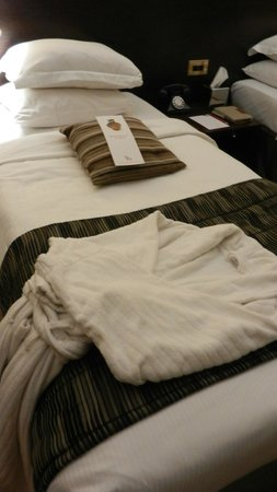 The Sanctuary House Hotel : Robe and chocolate on pillow
