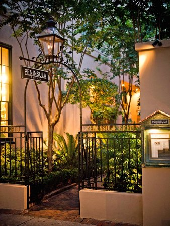 Peninsula Grill: Flickering lanterns invite guests to stroll along the hand-pointed brick alley.