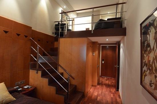 Hotel Claris: Staircase to upper level of duplex room at Pau Claris, Barcelona.