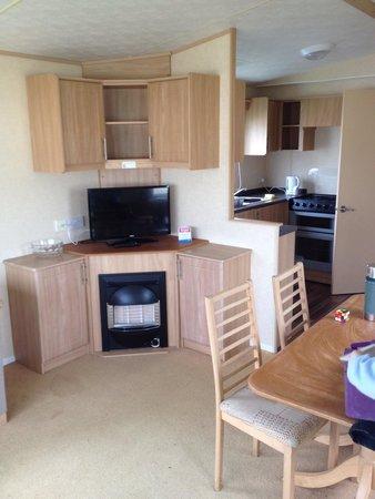 Brynowen Holiday Park - Park Resorts: Lounge, kitchen area of caravan. Lovely size