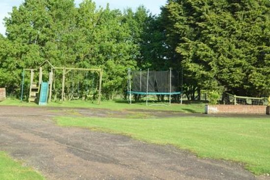 Bucks Farm Holiday Cottages: View of part of the play area