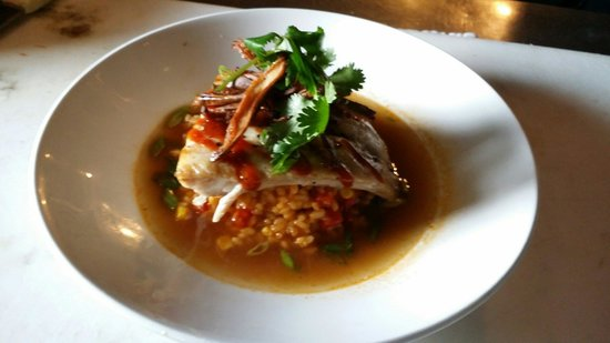 Seared 1200 Chophouse: Grilled Cobia special. Red curry risotto with a lobster, miso and shiitaki mushroom broth. Roast