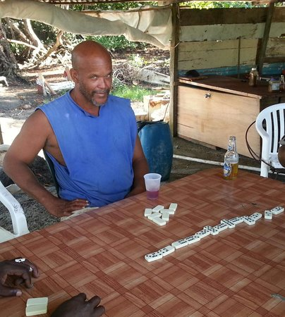 Atlantic Shores Riding Stables: Max enjoying a drink and game of dominoes