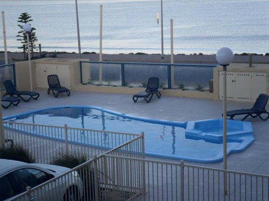 Baybeachfront: view of pool/beach from 1st floor apartment on communal balcony