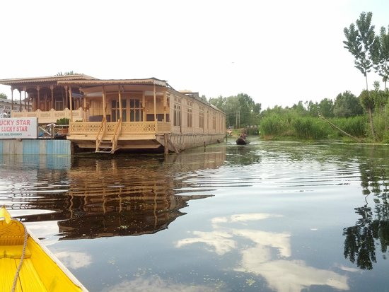 New Lucky Star Group of HouseBoats: View of the entire house boat and the shore!
