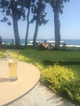 Barut Kemer : bar patio over looking grass area and beach