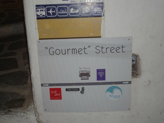Open Garden Restaurant & Lounge: Street sign of Gourmet Street with restaurants listed