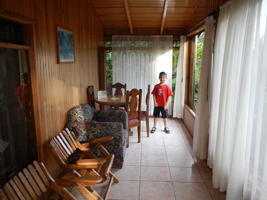 Los Pinos - Cabanas y Jardines: Entry area with dining table and chairs to hang out in