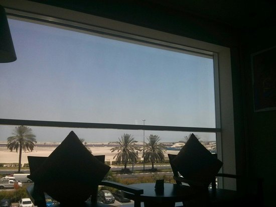 Hues Boutique Hotel : View out of the window from the bed. The windows are tinted so it doesn't look as bright as it i