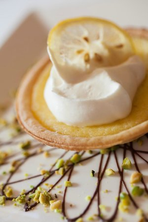 The Culinary Institute of America: Lemon Tart with Pistachios and Whipped Cream from Ristorante Caterina de' Medici