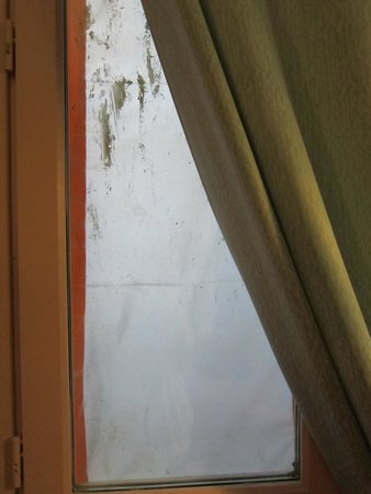 Perreyve Hotel: My papered over window.