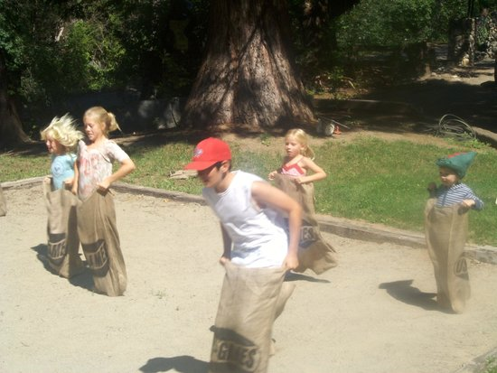 Coffee Creek Ranch: Sack race in our sand pit!