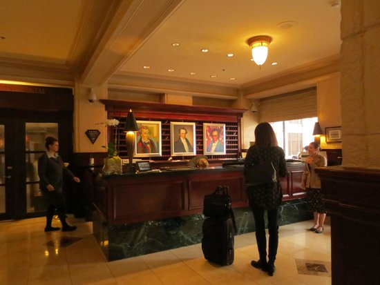 InterContinental Stephen F. Austin: Historic check in desk with modern paintings of Stephen F. Austin