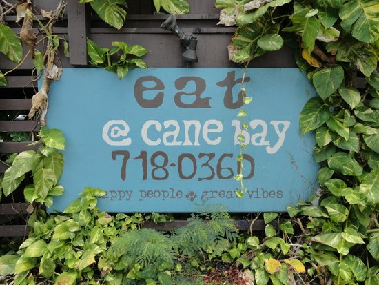 Eat at Cane Bay: I like the natural growth around the sign.  :)