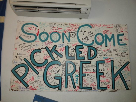 """Pickled Greek : Wall decor of the """"coming soon"""" sign."""