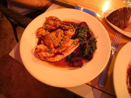 """Harvest Moon Cafe: Grilled half chicken """"al Mattone"""" with spiced carrots, Lacinato kale and Romesco sauce"""