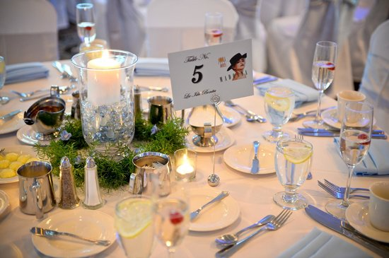 Salem Waterfront Hotel & Suites: Place settings with Madonna labeled tables. Photography: Bharat Parmar