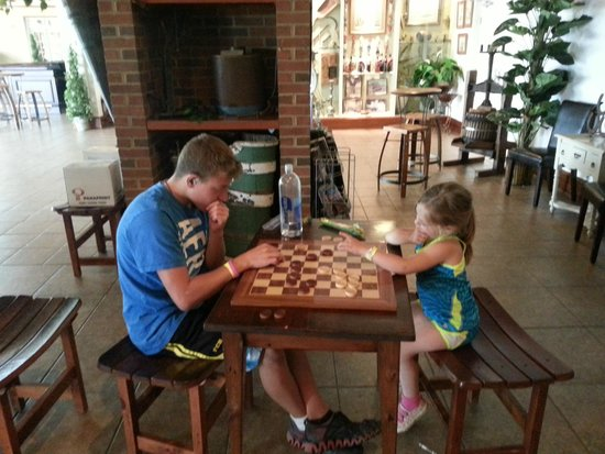 Prince Michel Winery: kids playing checkers outside tasting area