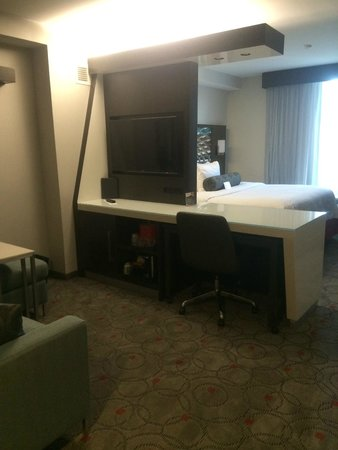 Cambria hotel & suites Washington DC Convention Center : Built in tv, desk and frig. below