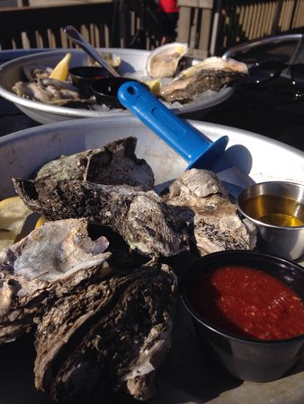 Snapper Jacks: Raw or steamed oysters! Nice relaxing afternoon on the roof top bar, listening to local music, a